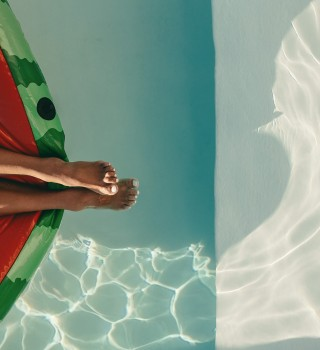 a woman lounging in the pool