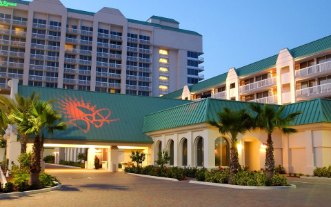 Front of hotel with teal colored roof