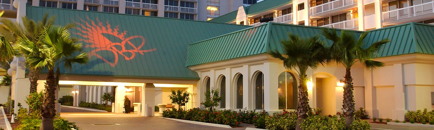 Hotel entrance with teal colored roof top