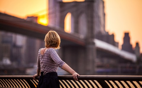 Woman looking at bridge city view