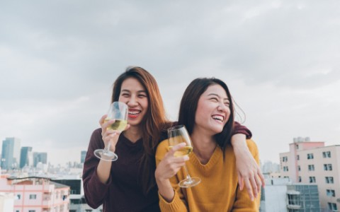 Two women drinking wine