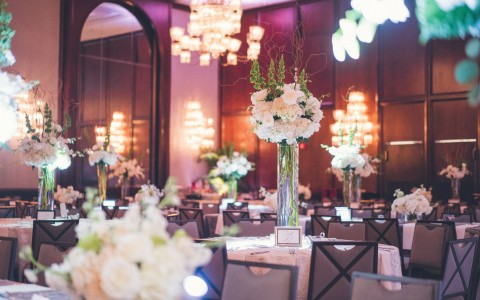a reception venue with purple up lighting
