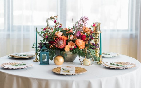 a table with a colorful floral centerpiece