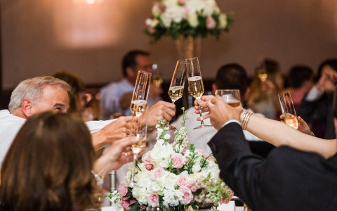 people drinking champagne during a wedding toast