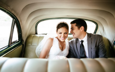 a couple after the wedding in a classic car