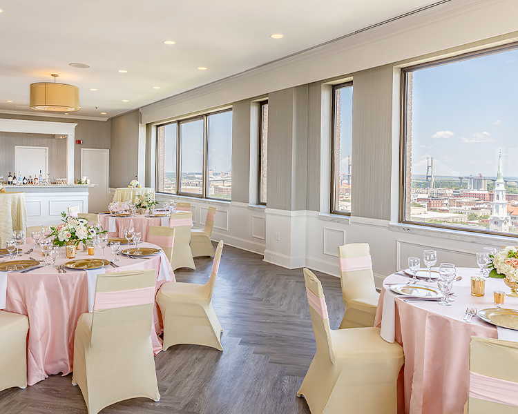 The harborview room with lots of light and round tables