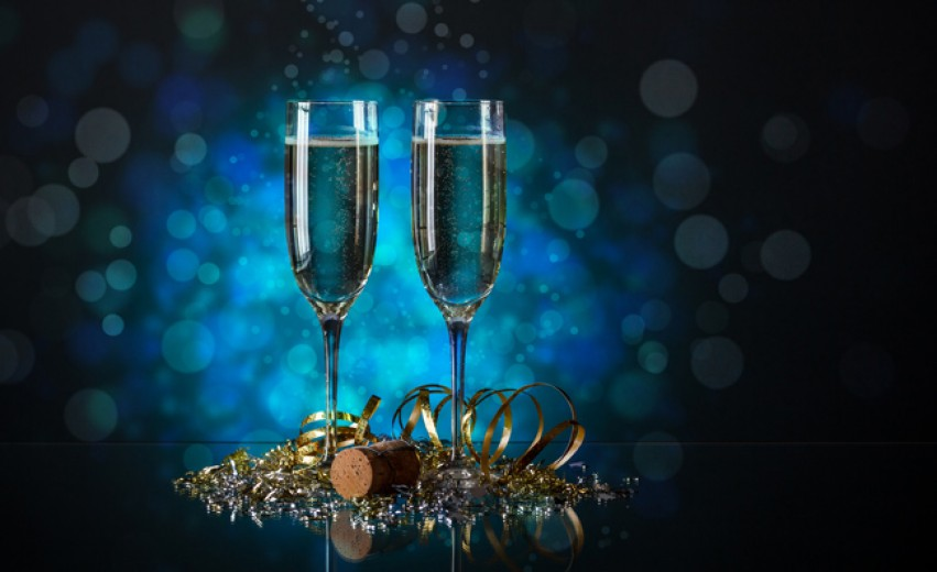 champagne glasses with new years eve party favors