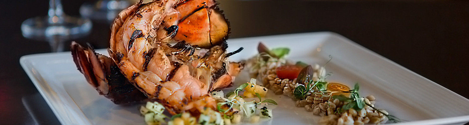 Grilled lobster on plate with rice