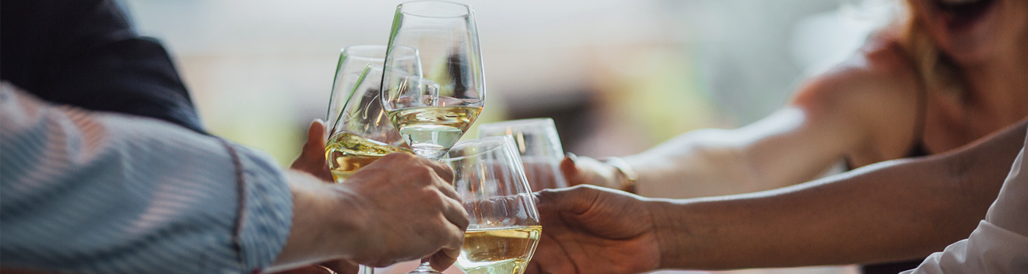 Close up of people toasting with white wine