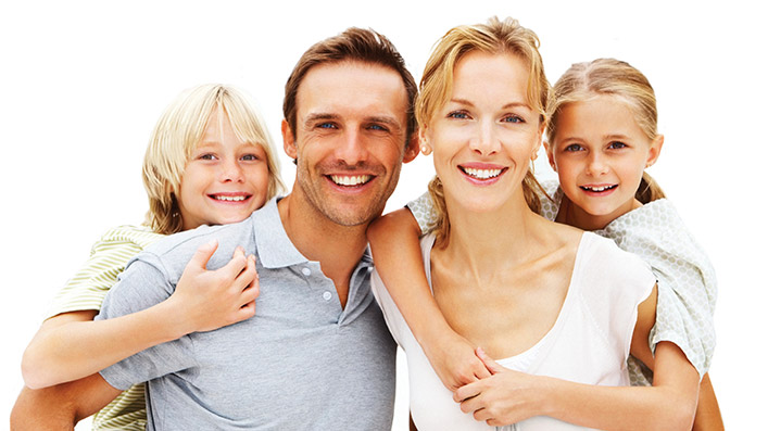 Family of four with white teeth