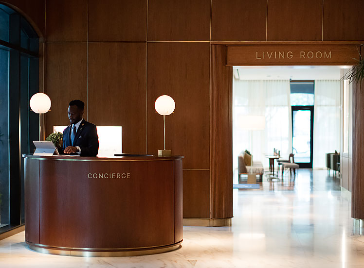 Man standing at concierge desk