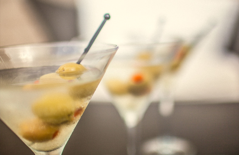 Three martini cocktails with olives