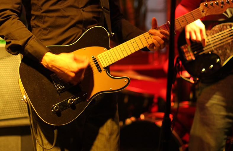Close up of man playing guitar