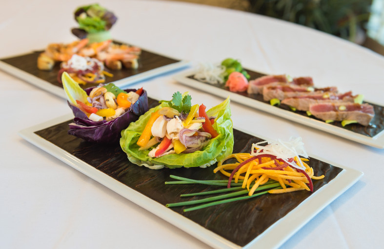 Platters of seafood dinners featuring calamari lettuce wraps and tuna