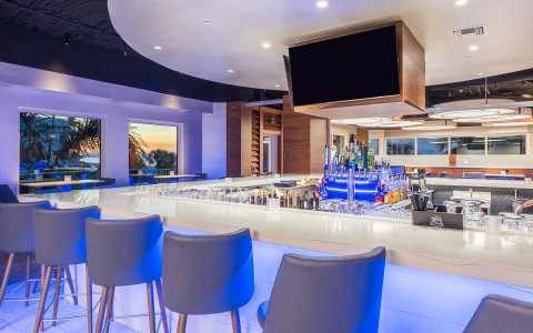 modern style bar and five barstools in a restaurant