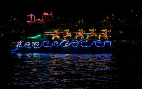 boat adorned with holiday lights