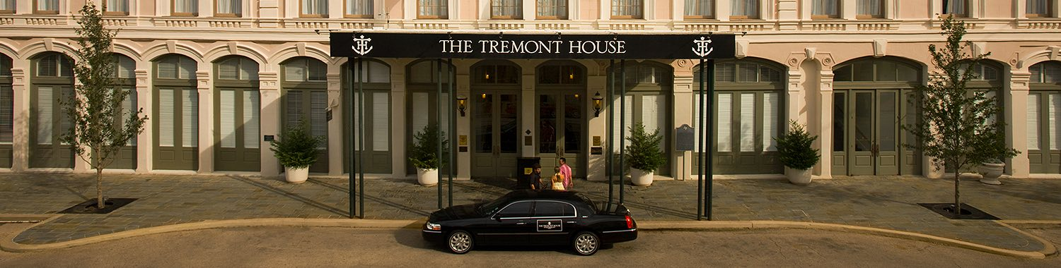 Exterior of the Tremont House with a car in front of the entrance