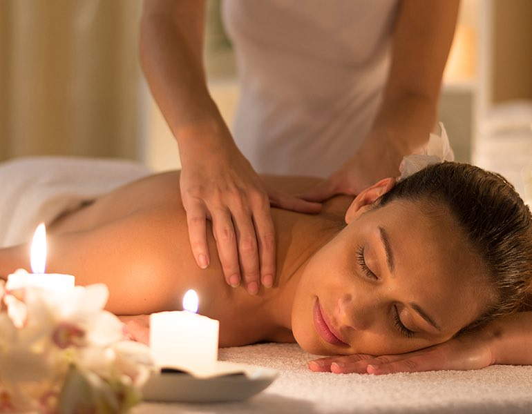 A woman getting a shoulder massage at the spa