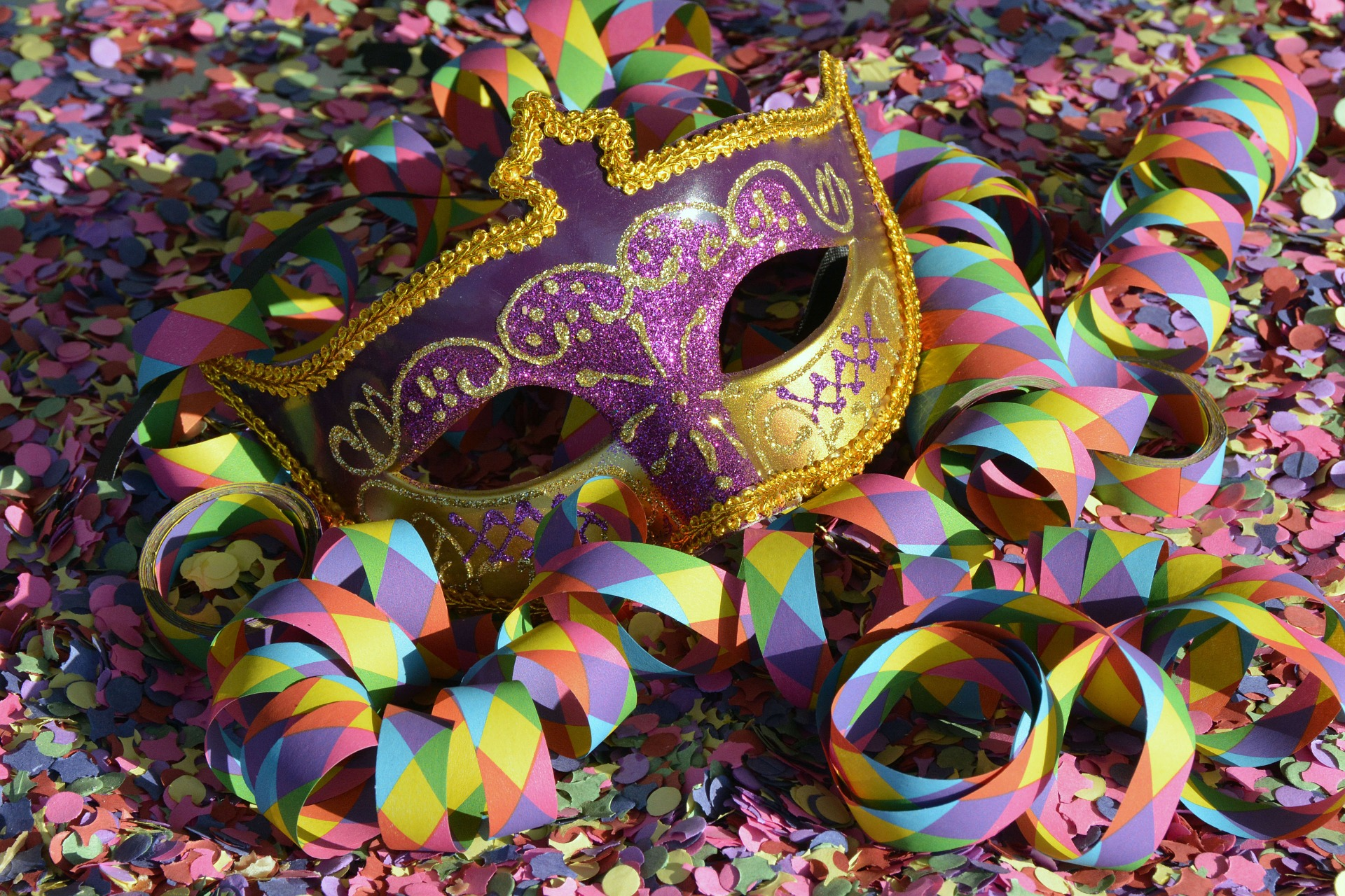 colorful mardi gras mask streamers and confetti