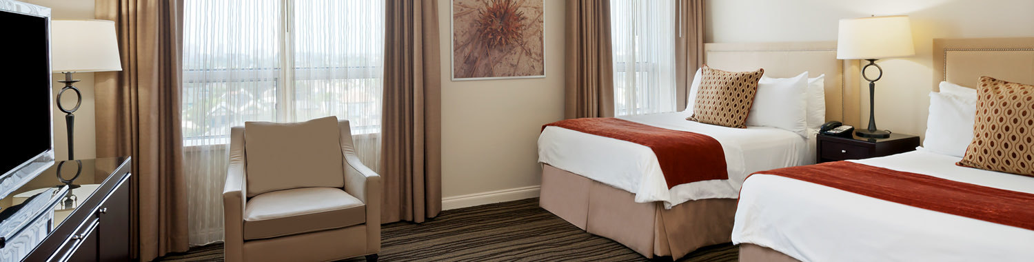 double bed bed room with burnt orange accent decorations