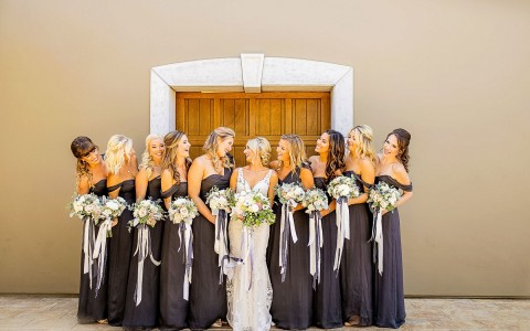 bride and her bridal party posing all in a line
