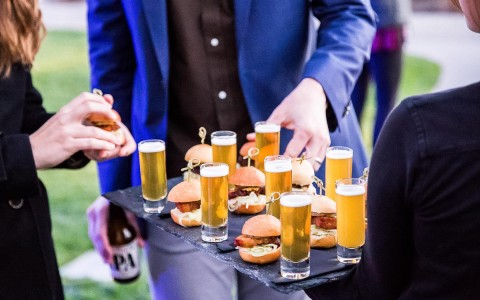 catering tray with mini burgers and beer shooters