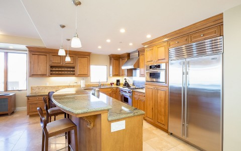 kitchen counters with bar and stools