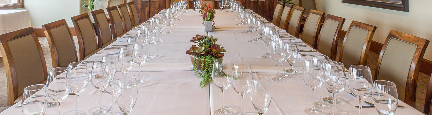 table set for an event with flowers and glassware