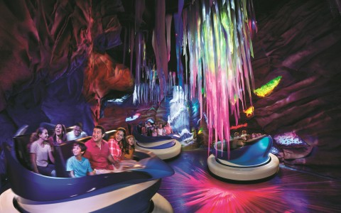 Colorfully lit cave themed ride at Seaworld