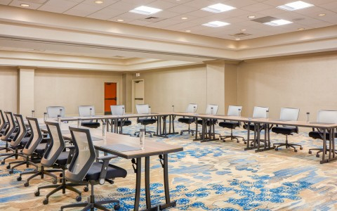 u-shaped classroom ballroom at close up of a board room table at Doubletree By Hilton Orlando Seaworld
