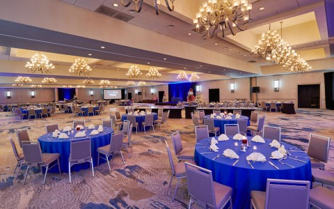 Doubletree By Hilton Orlando Seaworld event tables set up in the ballroom with blue lights