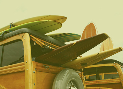 Two vans with surfboards