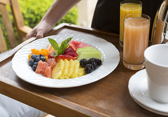Bed and Breakfast fruit platter with orange juice and grapefruit juice