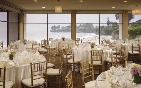event room decorated for a wedding with ocean views