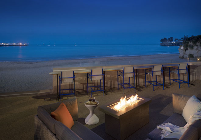 Fire pit and couches by the ocean