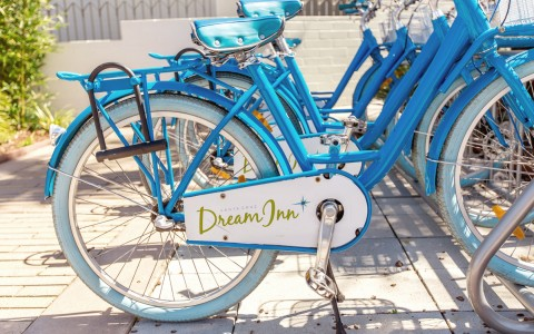 blue rental beach cruisers with dream inn logo