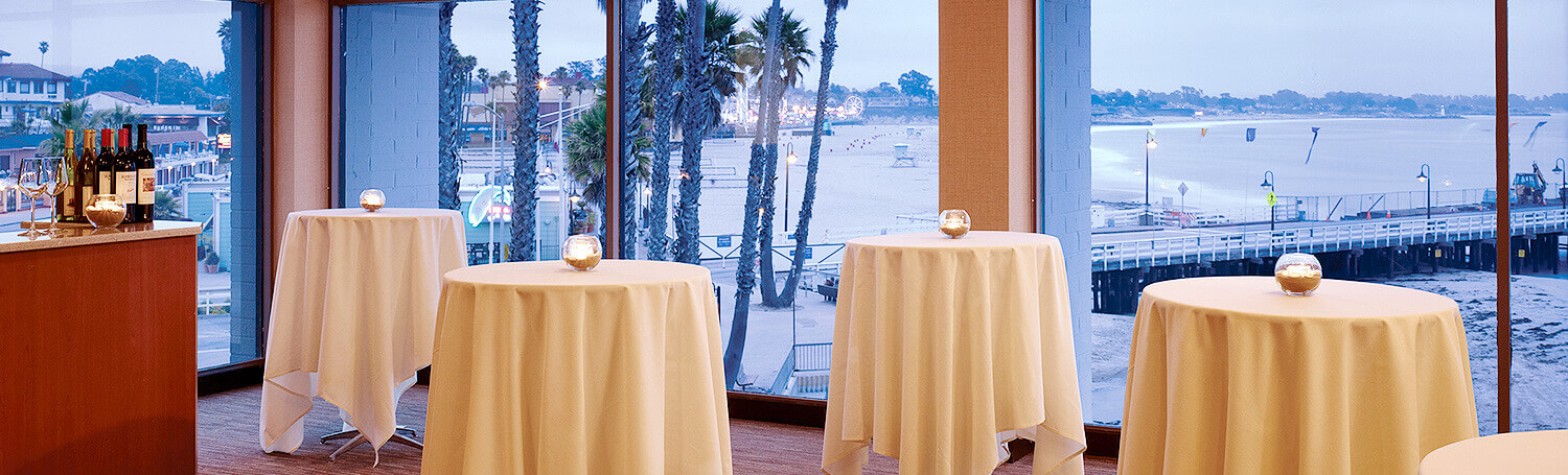 Event Space with four round tables at Dream Inn Santa Cruz