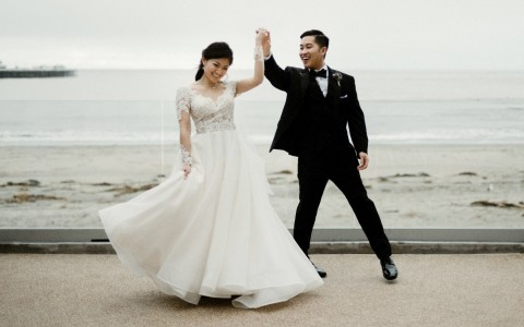 bride and groom dancing on the boardwalk