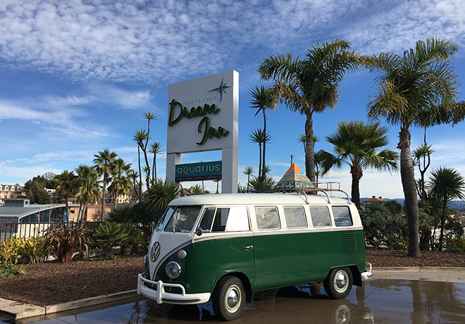 Classic Volkswagen van in front of Dream Inn signage