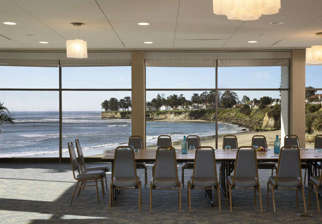 surf-view-room - event space with floor to ceiling windows overlooking the beach set for a board meeting