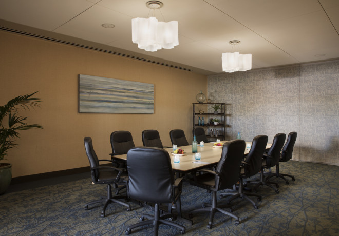 meeting room with rectangular table set for a board meeting