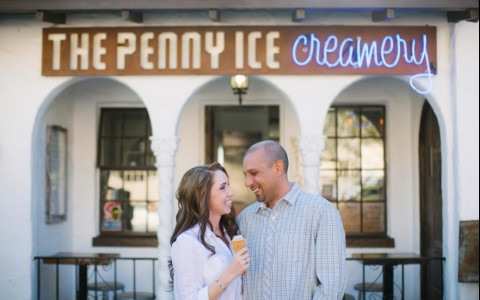 couple smiling outside of ice cream shop