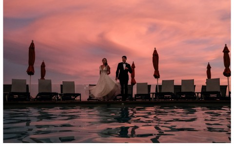 bride and groom by the pool