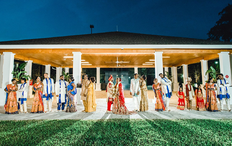 ethnic wedding couples posing for a group picture