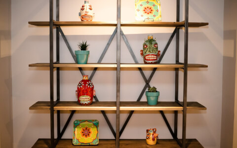 Wooden shelving filled with colorful ceramics
