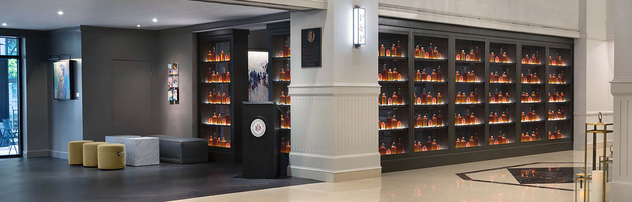 Black shelving with bottles of bourbon displayed