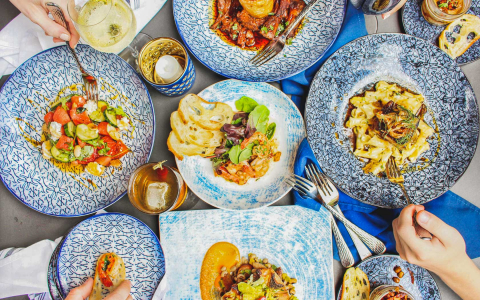 Overhead shot of blue plates with different dishes