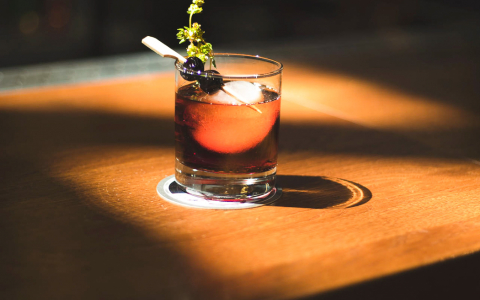 Bourbon with garnishing blueberries on stick