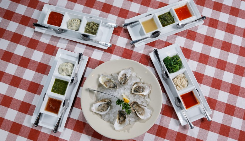 raw oysters with sauces