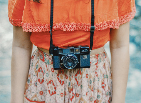 woman wearing a camera around her neck
